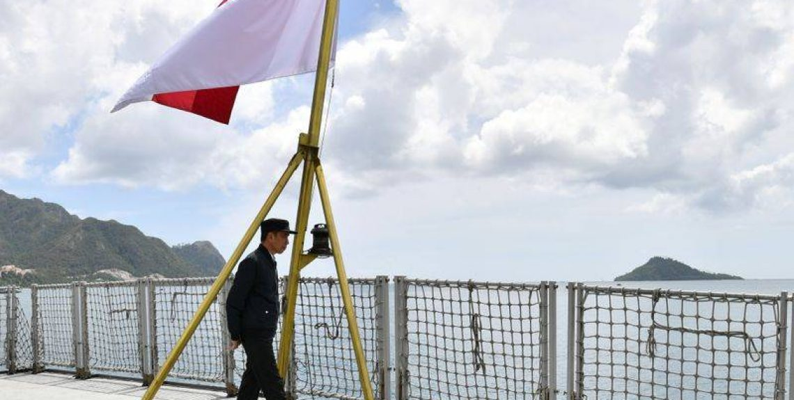 FILE PHOTO: Indonesia Presidents Joko Widodo walks next to a national flag during his visit at a military base in Natuna, near South China Sea, Indonesia January 8, 2020, Laily Rachev/Courtesy of Indonesian Presidential Palace/Handout via REUTERS/File Photo